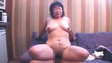 Old mature asian woman is taking a piss